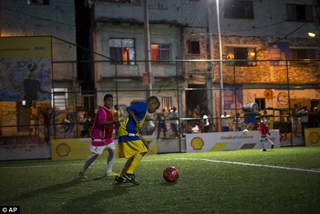 1410435827622_wps_6_children_play_soccer